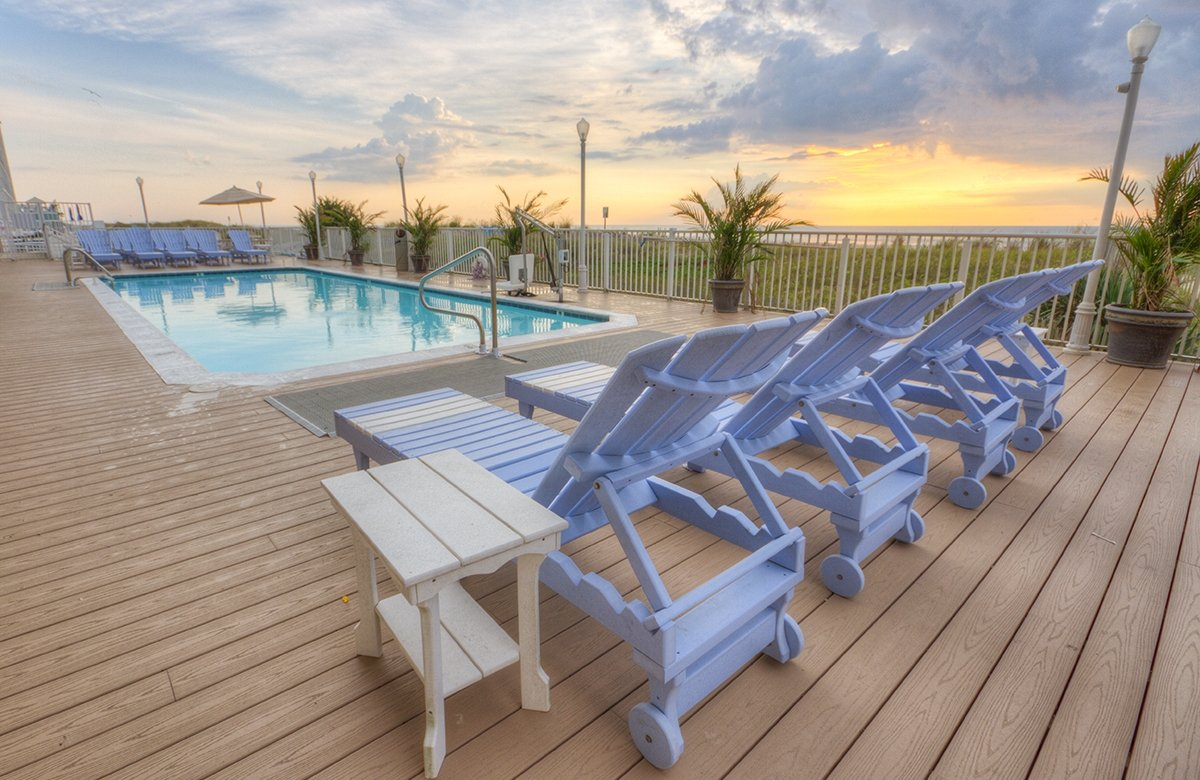 sun deck with chair at outside pool